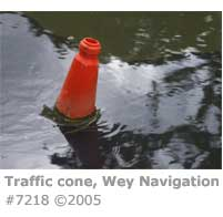 TRAFFIC CONE IN RIVER